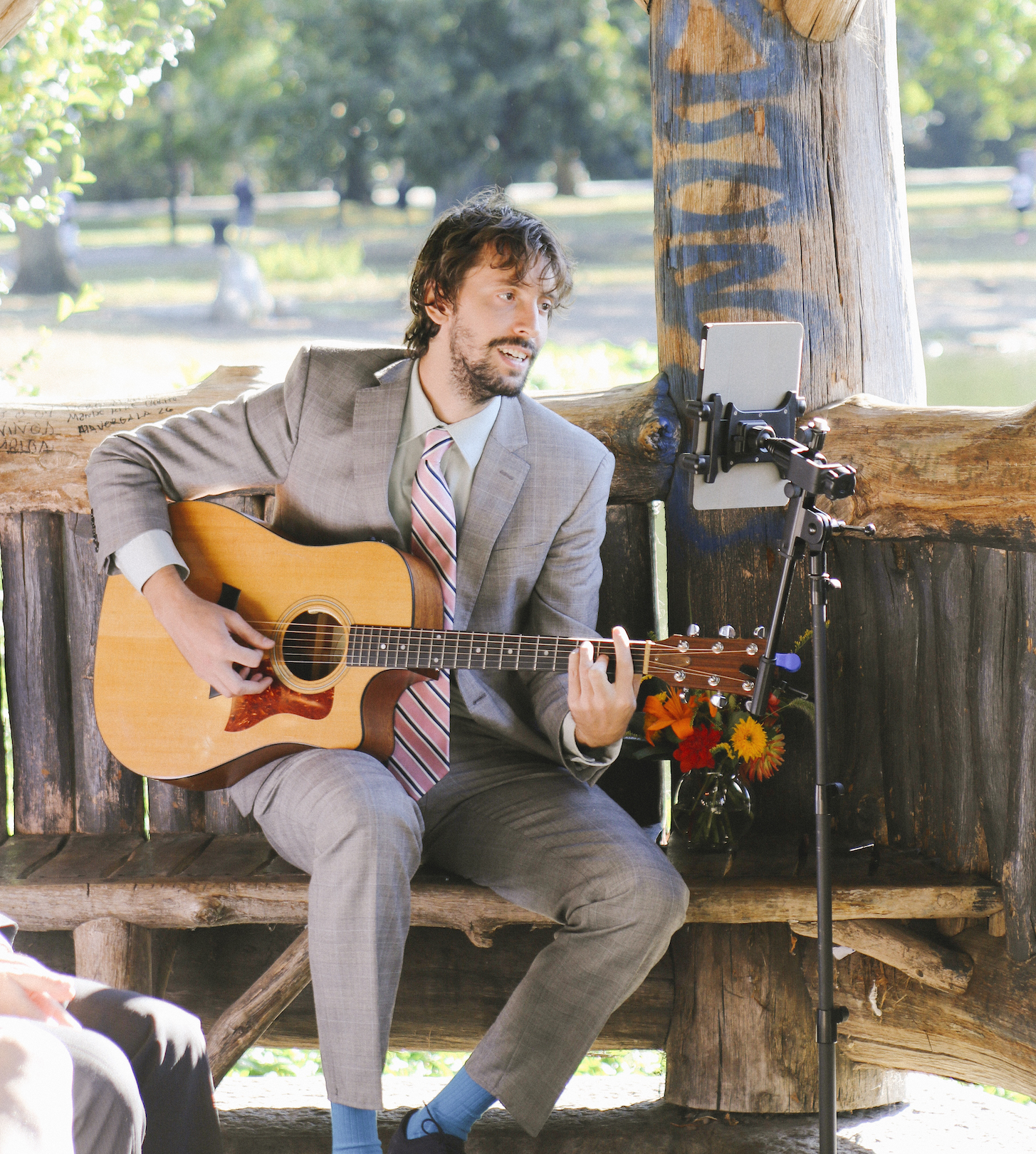 Singing and playing acoustic guitar for an outdoor ceremony in Central Park